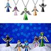 Two examples of coloured crystals angels pendants shots. Above on the white, under a scene with snow and blue bokeh background.