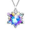 The Swarovski crystal snowflake on a chain. The crystal shines in various colors, from blue and purple to yellow.